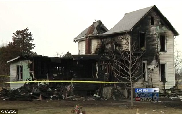 Carter strapped the baby in a car seat and dropped her out of a second-floor window. The 21-year-old died from smoke inhalation (pictured, the home on the 900 block of N Galena Ave)